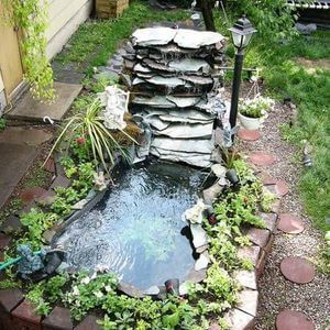 80 Garden Pond Ideas and Designs - Golly Gee Gardening #gardenpond #gardenponds #gardeninspiration #gardenideas
